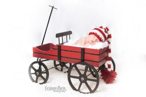 Little boy in Christmas waggon