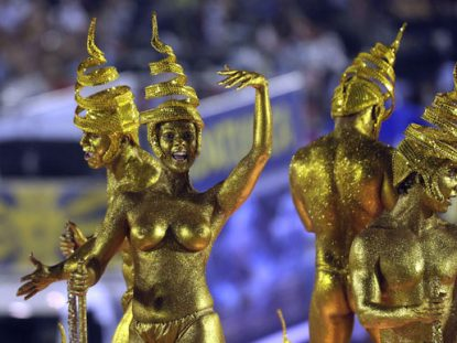dancers covered in golden paint at Rio Carnival