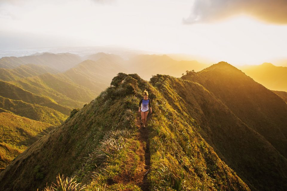 Warm sun photo of girl on mountain