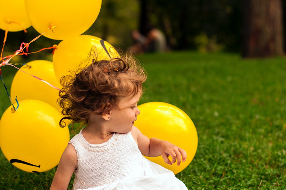 child with balloons photograph