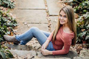 High School Senior girl sitting on steps for senior portraits