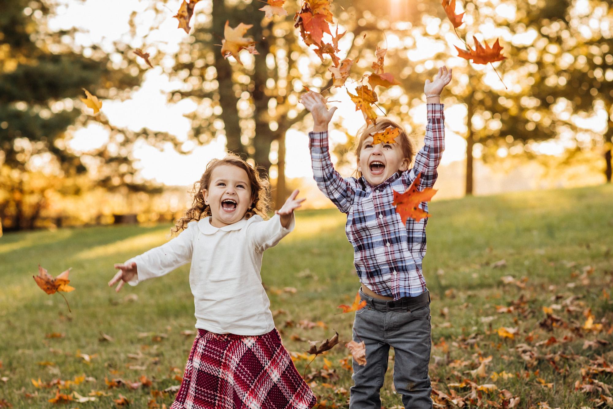 Kids Throwing leaves in the air