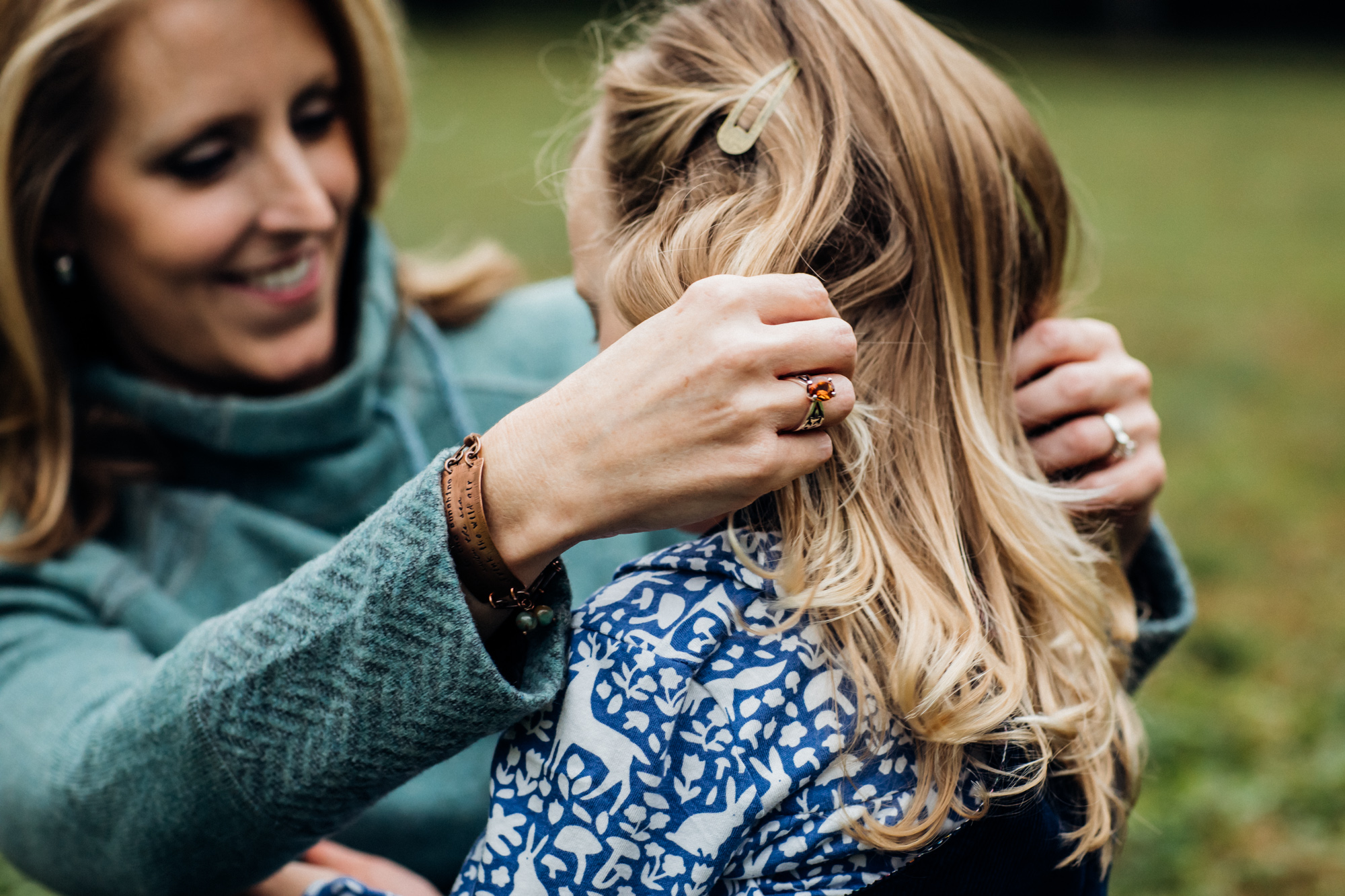 Mom playing with daughters hair